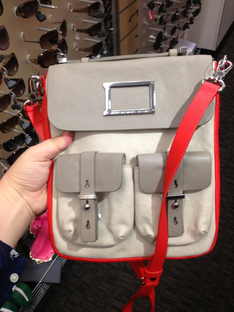 Perfect color-blocking (not so much that it'll look dated when the trend subsides in a year); perfect bright punch without veering into Neon Territory; perfect silvery gray and ivory that are cool and pale yet murky enough to hide dirt. Crossbody strap for maximum ergonomics, comfort, and security. Cool looking hardware. Not too prominent a brand logo. SO LOVELY!