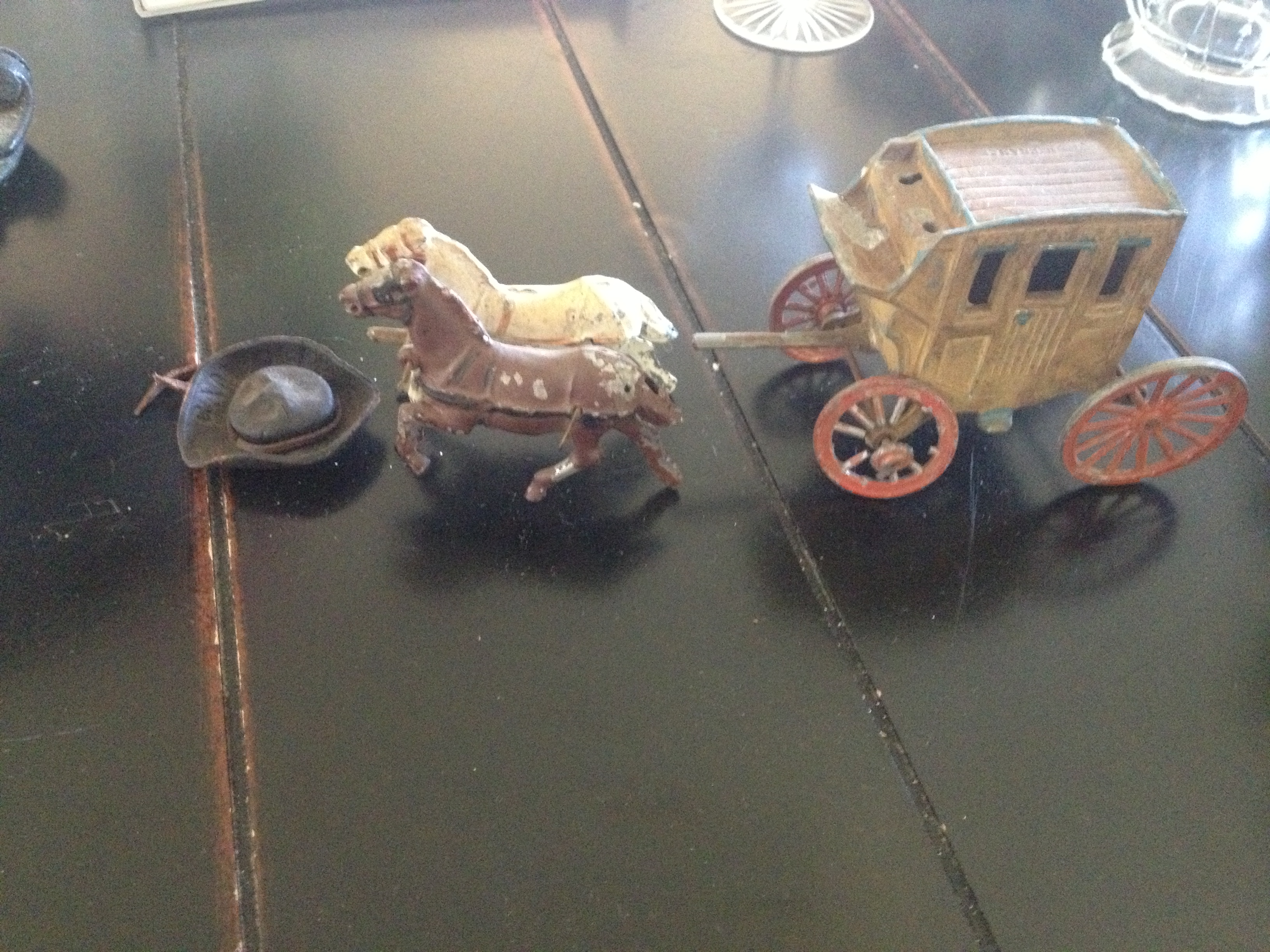 Antique metal horse and wagon toys.