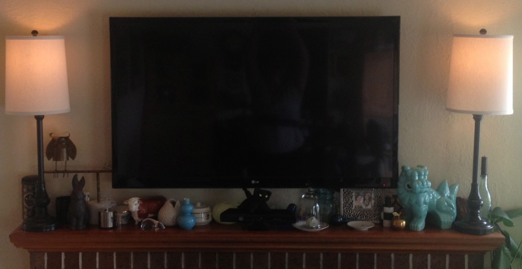 A picture of my TV, styled in with antiques and other decorative objects.